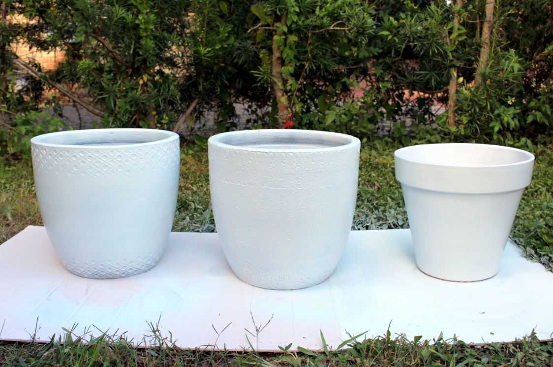 Spray painting pots white for a neutral look