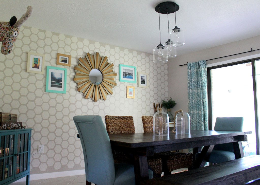 Adding a new chandelier to the dining room with a chandelier from West Elm.