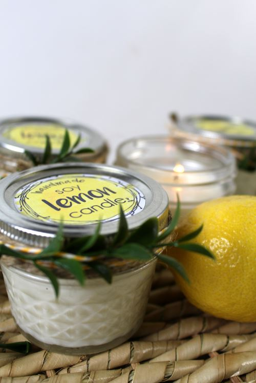Using labels, twine, and plants on soy candle containers.