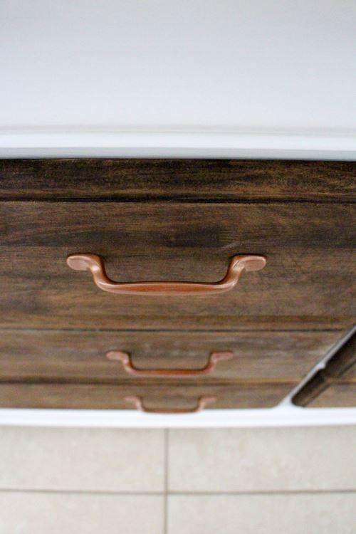 Copper handles for dresser.