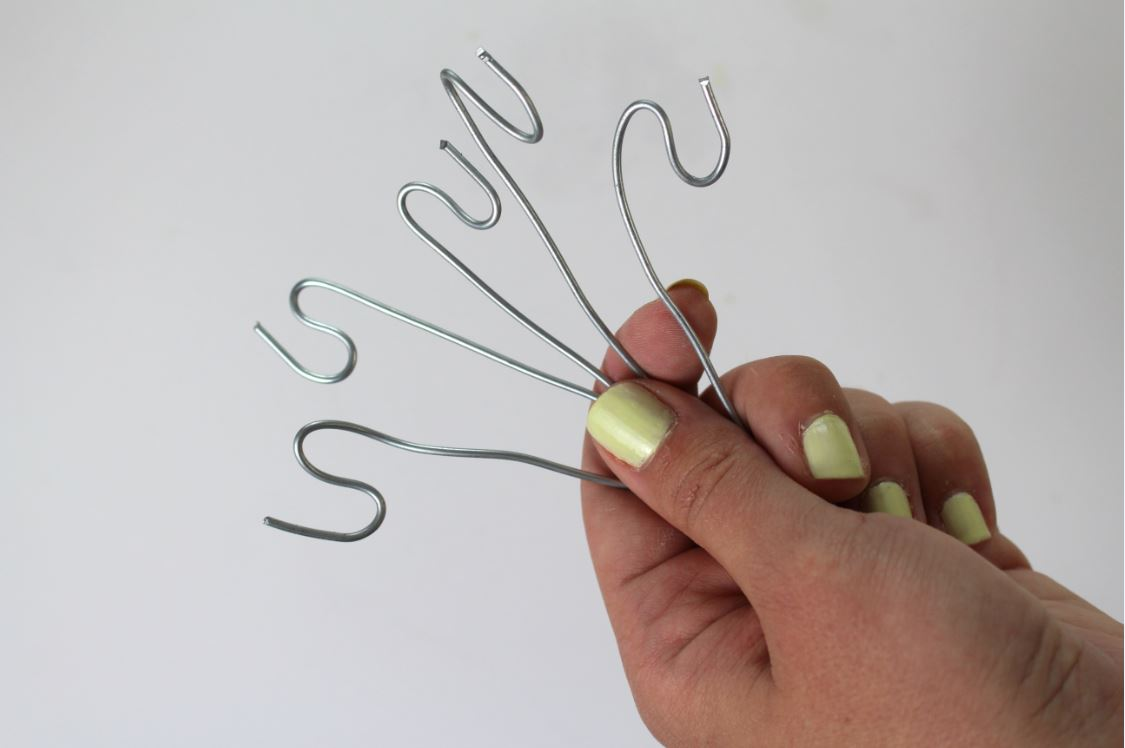 Bend the wire to hang your garden markers from