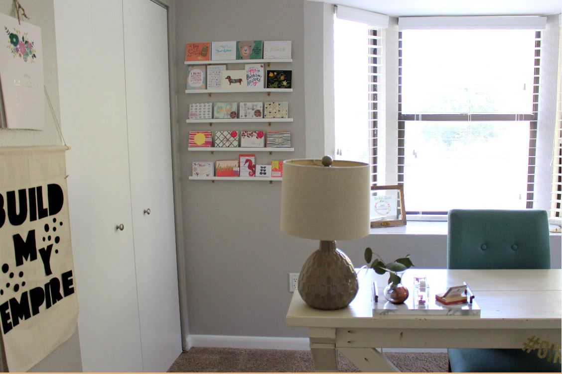 Home office with greeting card display wall