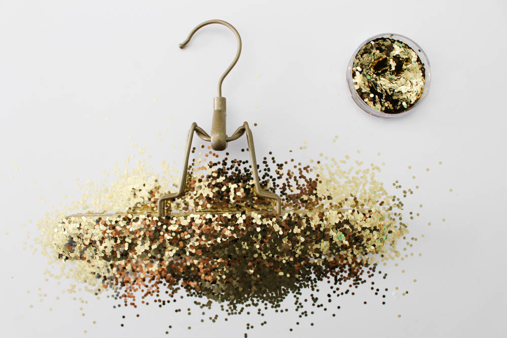Sprinkling glitter onto a hanger - Within the Grove