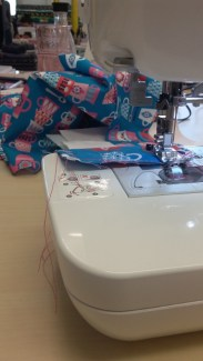 Trying out the sewing machine