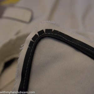 Image: Inserting the faux leather piping.