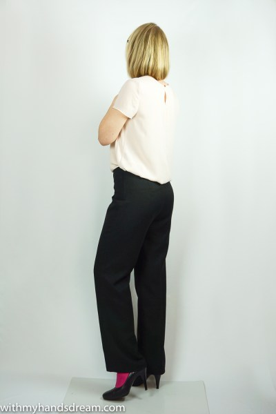Black wool crepe trousers, side view.
