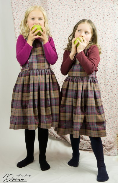 The girls in their pinafores. Apples are yummy!