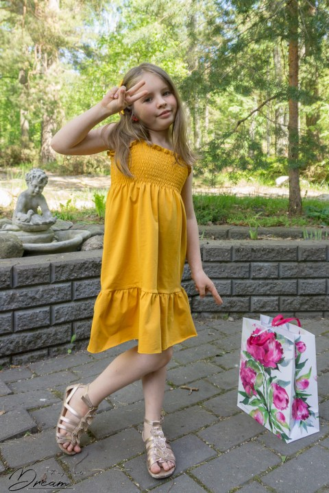 Yellow shirred dress.