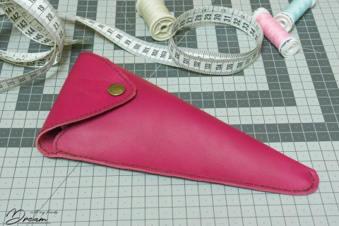 The finished scissors case closed.