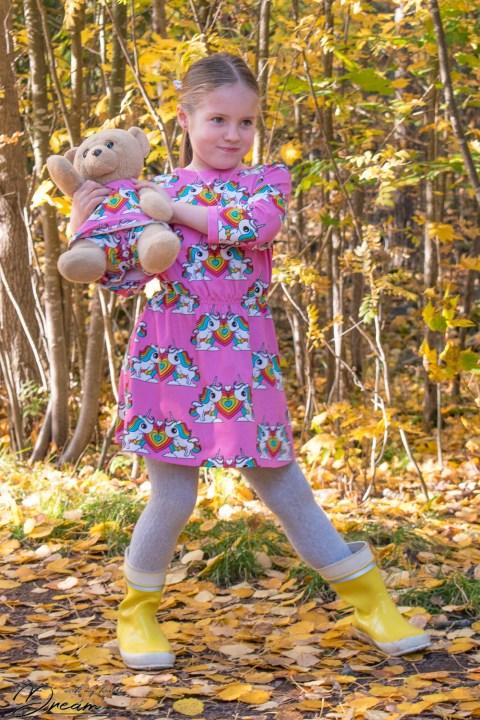 Ottobre 1/2018 31. Viivat dress in Rainbow and unicorn print jersey.