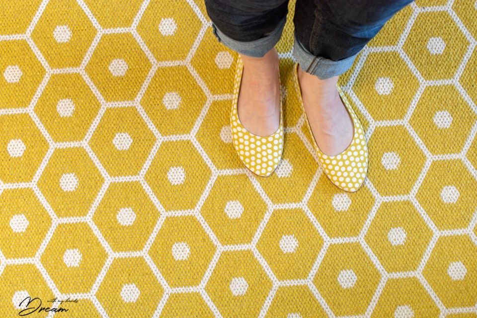 The shoes match our kitchen carpet!