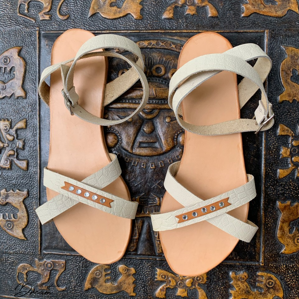The finished pair of leather sandals.