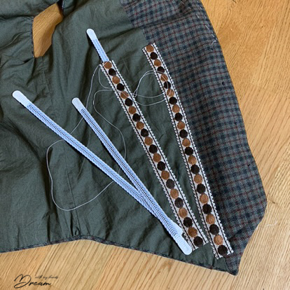 Adding the boning to the waistcoat.