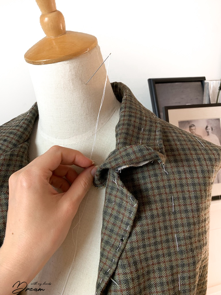 Fastening the top collar of the waistcoat.