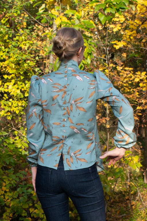 The finished shirtwaist blouse from the back, showing the button closure.