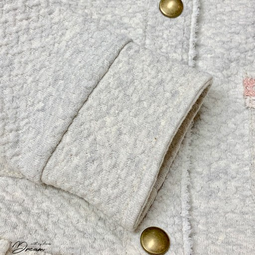 The jacket cuffs.