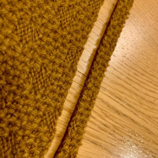 Straightening the edge of the fabric.