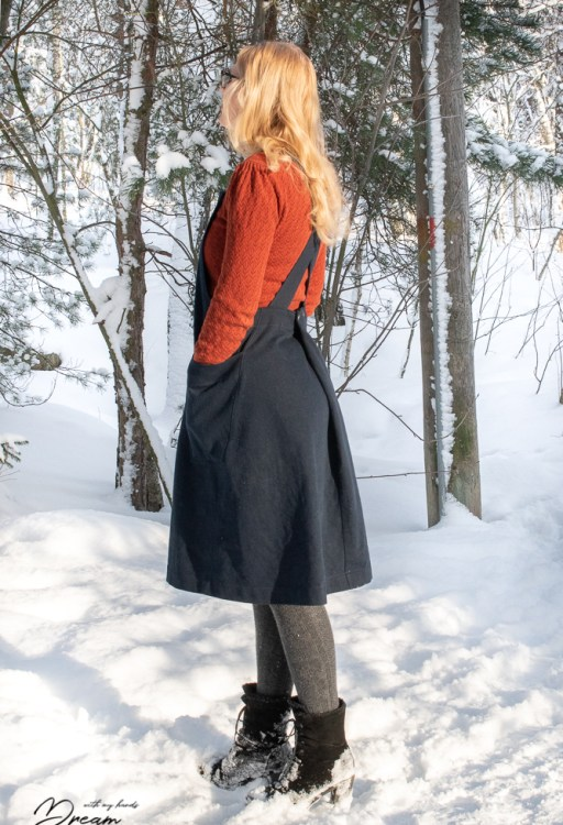 The side view of the apron dress.
