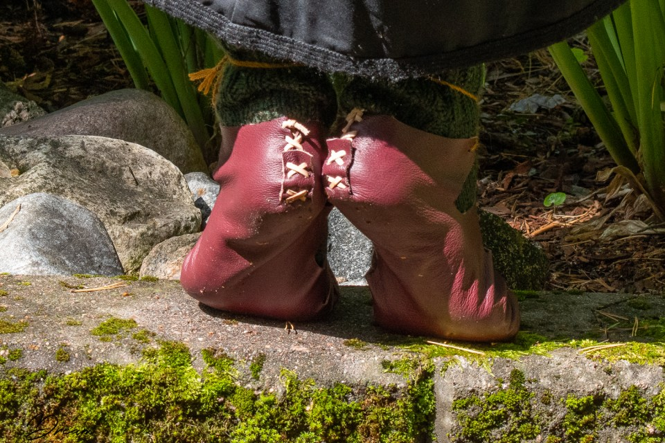 The stitched heels of my iron age shoes.