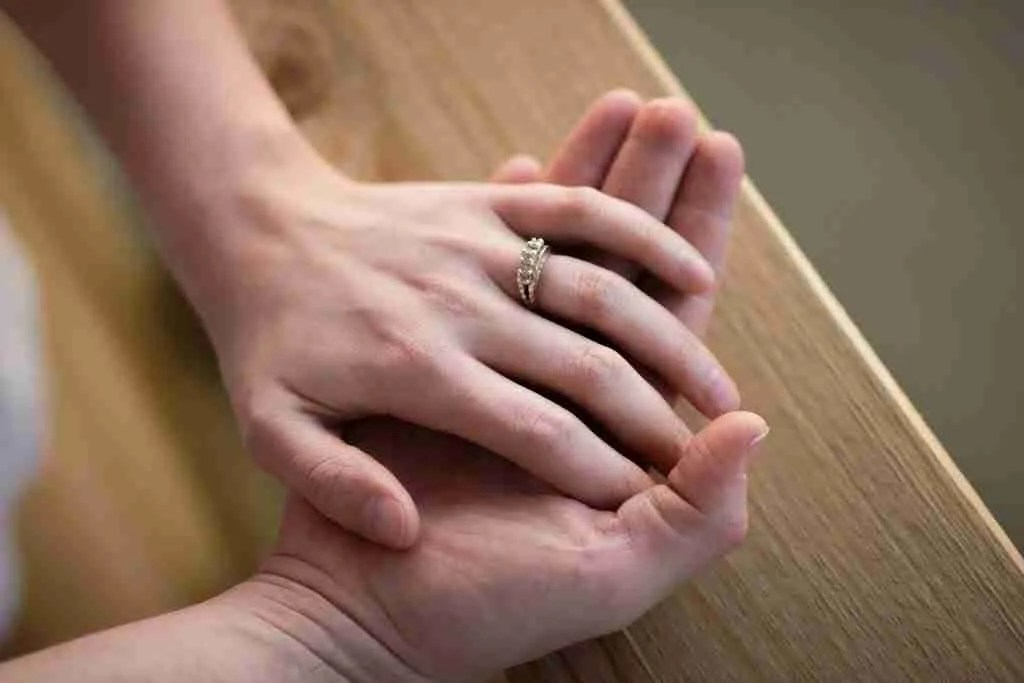 close up of hands with wedding rings