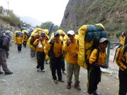 Porters... look at their shoes! 28 kilos