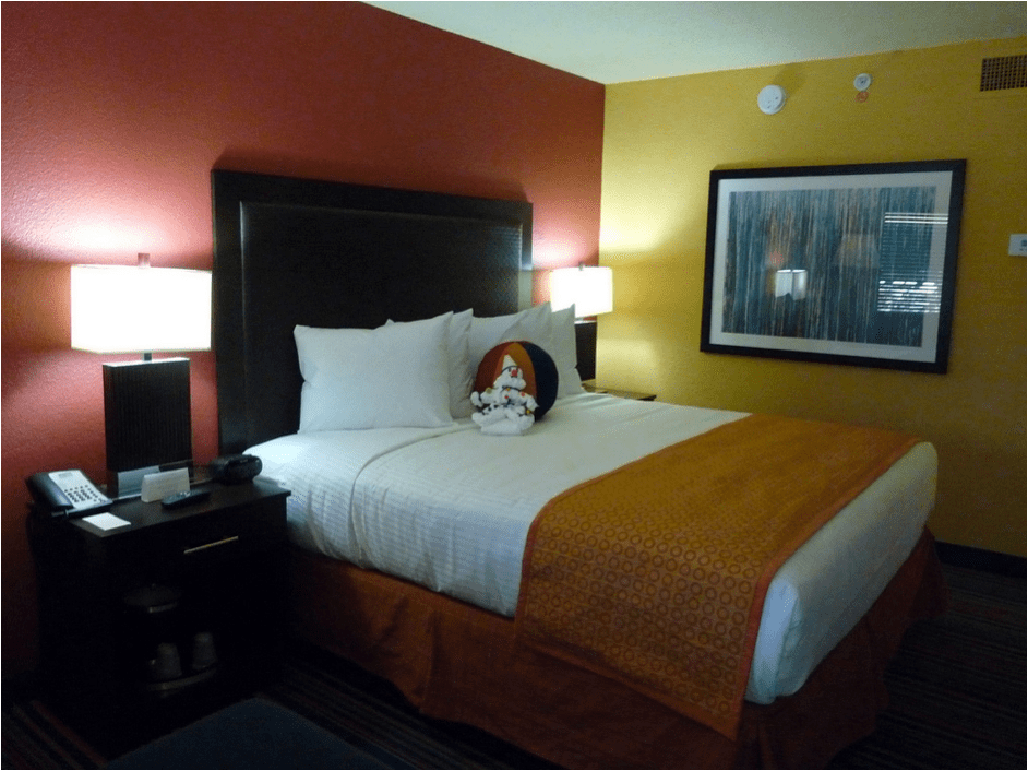 Image of a neatly made hotel bed