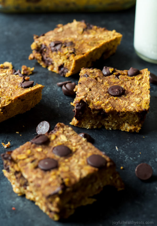 Skinny Chocolate Chip Pumpkin Bars are filled with fall spices, pumpkin puree, oats, and dark chocolate! All for only 107 calories a serving!