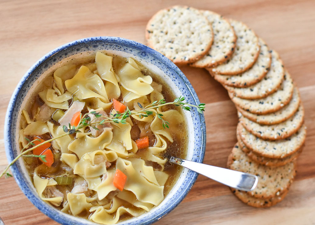 A bowl of Easy Slow Cooker Chicken Noodle Soup goes perfectly with your favorite crackers