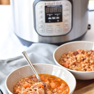 Two bowls of Instant Pot Bean and Bacon Soup in front of an Instant Pot