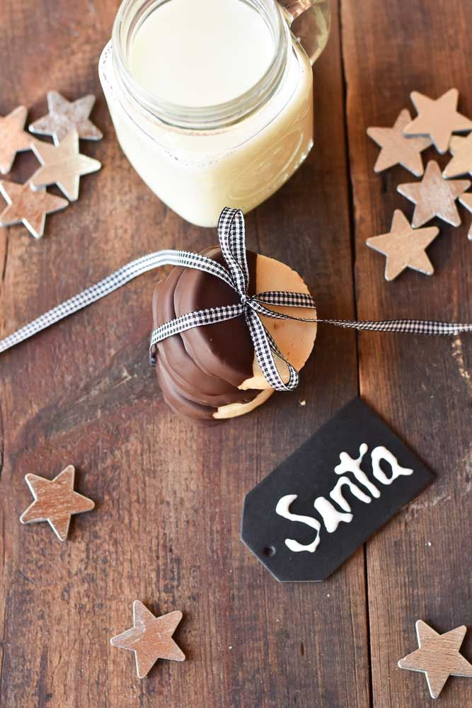 Dark Chocolate Dipped Almond Shortbread Cookies overhead with a santa tag