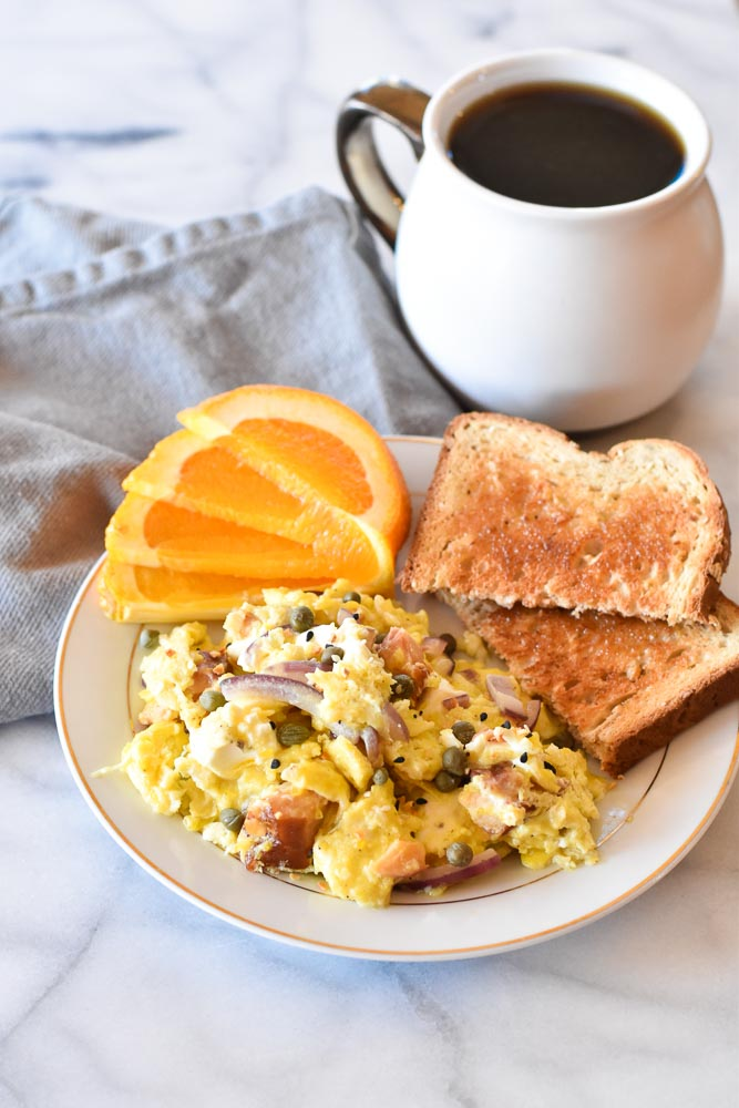 Salmon Breakfast Scramble on a plate with coffee