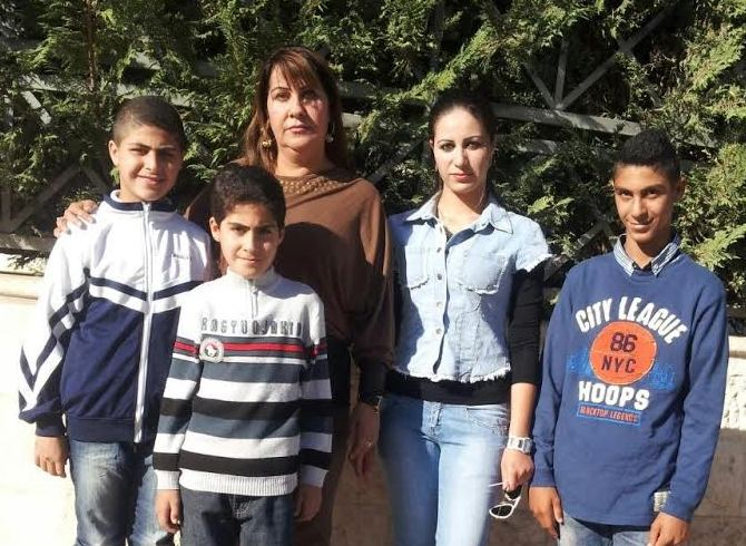 The lead plaintiff, Ms. Sundus Saleh, with her children in Jordan
