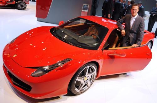 Formula One world champion and adviser for Scuderia Ferrari, Michael Schumacher poses with Ferrari's new 458 Italia