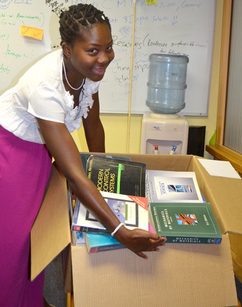 FREE BOOKS: Charmaine Pule, Media and Marketing Officer for the SRC shows Wits Vuvuzela some of the books they have collected for their book drive. Photo: Pheladi Sethusa