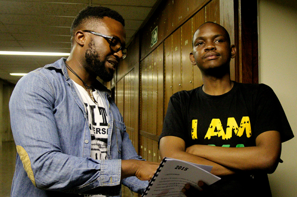 IT'S PYA DAY: Project W's Jamie Mighti (left) attempts to argue a point to PYA member and former SRC president Sibulele Mgudlwa (right) after Project W walked out of the SRC's fi rst meeting over the selection of portfolios. Mgudlwa attempted to bring Project W back to the meeting. Photo: Nqobile Dludla