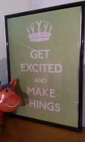 A grinning horse bust with a sign saying 'Get excited and make things'