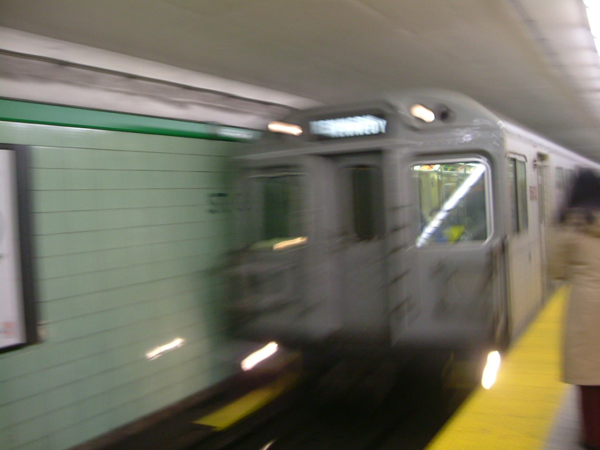 A subway train entering a station