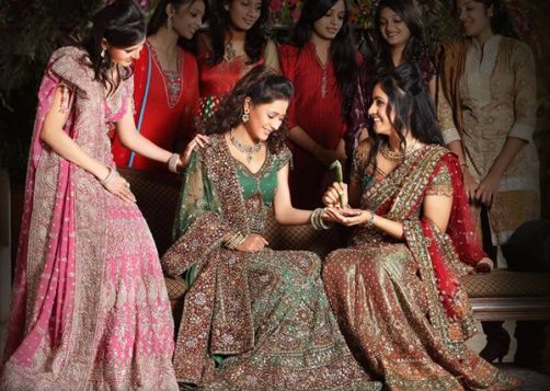 Must have wedding photos with friends the one where they pretend to put mehendi