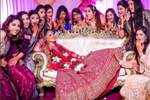 Squad photos you must have from your indian wedding. | Indian wedding photos bride with her best friends | bride in a red and gold lehenga on a safa | happy Indian bride | cute poses for your Indian wedding