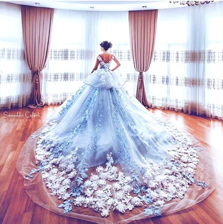Trend Alert - Trains for the Indian Bride | Curated by Witty Vows | A beautiful blue gown for the cocktail with a long train