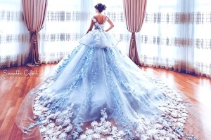 Trend Alert - Trains for the Indian Bride   Curated by Witty Vows   A beautiful blue gown for the cocktail with a long train