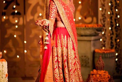 Red and gold sabyasachi lehenga with broad vertical floral motifs and all over gold work blouse