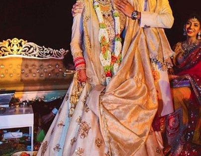 Ivory and blush hued silk sabyasachi lehenga