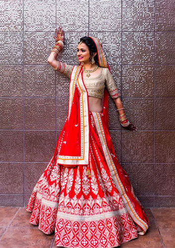 Red Lehenga with gota gota work, dull gold blouse and red net dupatta with gota border | Anita Dongre | Curated by Witty Vows