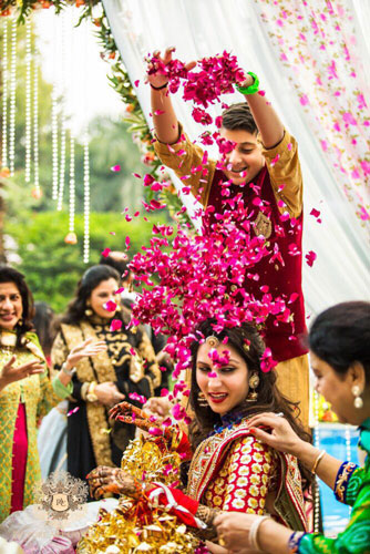 PICTURES THAT PROVE EVERY INDIAN BRIDE MUST GET A PICTURE WITH A FLOWER SHOWER | A bridal entry in style | Ceremonies are more animated | Must have picture with your little brother indian weddings | Curated By Witty Vows