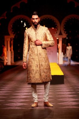Beige and gold bandhgala sherwani with white churidar | Raghvendra Rathore | Curated by Witty Vows
