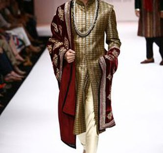 Dull gold bandhgala with creme churidar and deep maroon shawl with embroidery | Shyamal Bhumika | Curated by Witty Vows