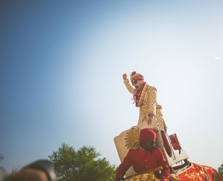 pictures every indian groom must have with his friends from the wedding | Groom on the elephant | Curated by Witty Vows