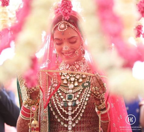 Traditional red Ghoonghat veil style for the Indian Bride   Witty Vows
