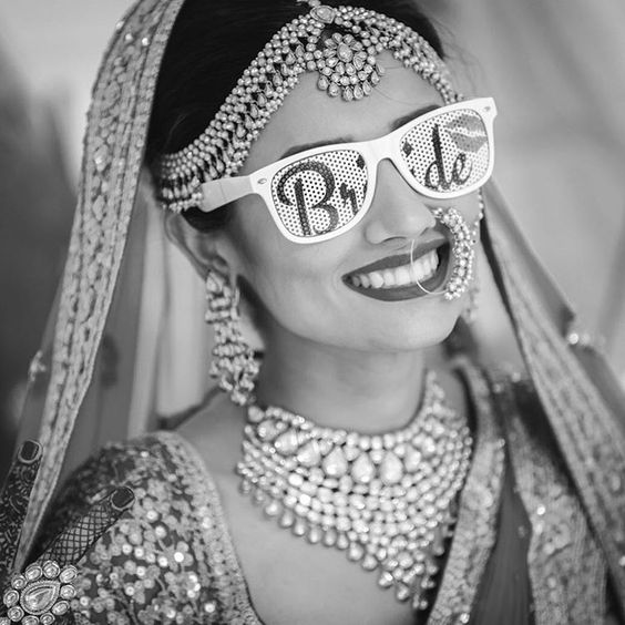 Sunglasses for an Indian Wedding | a must for the couple | Curated by witty vows | Selfie and photo of Indian bride with sunglasses